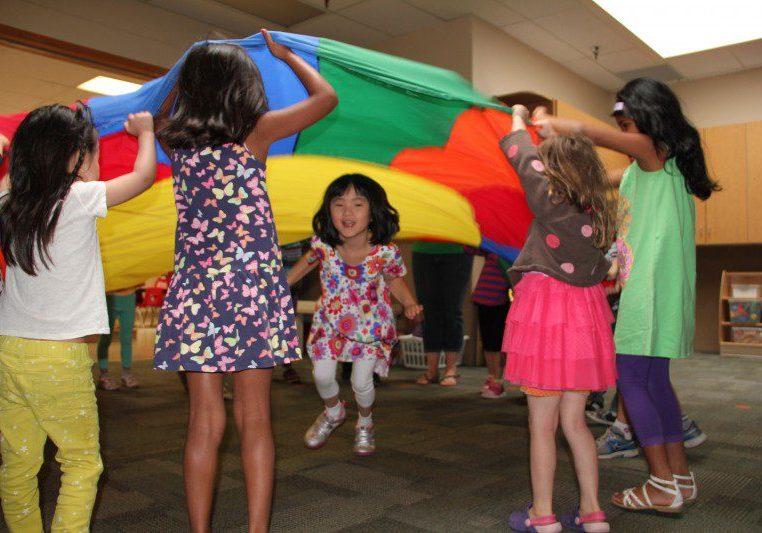 girls playing parachute